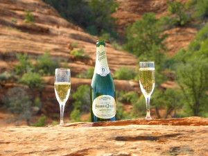 champagne poured into 2 glasses at a popular sedona wedding venue