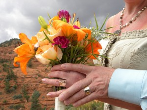 A women holds a bouquet of flowers at one of the popular Sedona weddings red rock locations