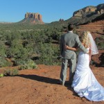 A bride and groom enjoying the view at wedding venue back o beyond
