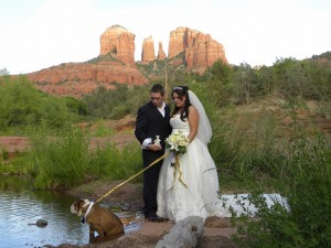 bride, groom and best pet in Sedona wedding by the water at Red Rock Crossing