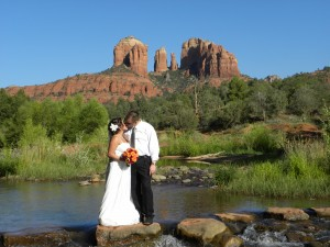 bride and groom take a moment in the middle of red rock crossing