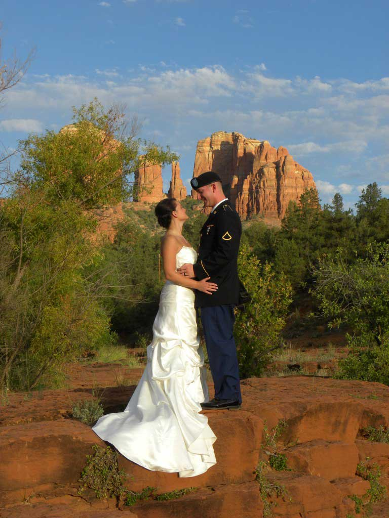 joy couple posing for sedona weddings